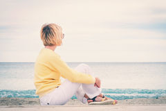 Young woman looking through the sea Stock Images