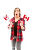 Young woman looking shocked with holding Canada flag Royalty Free Stock Photos