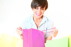 Young woman looking in shopping bag Royalty Free Stock Photography