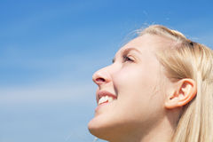 Young woman is looking into sky Stock Photos