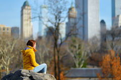 Young woman looking at skyscrapers in Central Park Stock Photography