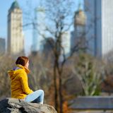 Young woman looking at skyscrapers in Central Park Royalty Free Stock Images
