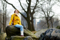 Young woman looking at skyscrapers in Central Park Stock Image