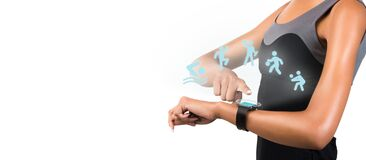 Young woman looking at smart watch while exercising