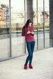 Young woman looking at a smartphone Royalty Free Stock Photos