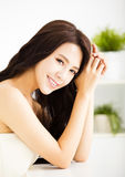 Young woman looking and smiling Royalty Free Stock Photography