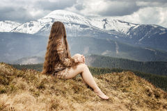 Young woman looking on snowy mount Stock Images