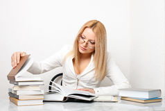 Young woman looking for some information in books Royalty Free Stock Images