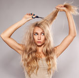 Young woman looking at split ends Stock Images