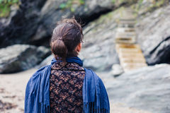 Young woman looking at steps on coast Royalty Free Stock Images