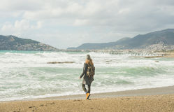 Young woman looking at stormy Mediterranean sea, Alanya, Turkey Stock Images