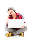 Young woman looking stressed using laptop Stock Photos