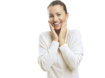 Young woman looking surprised against white background Stock Photo
