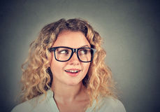 Young woman looking surprised curious stock image