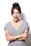 Young woman looking surprised on white background. Close-up of a young woman looking surprised on white background Stock Images