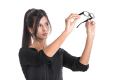Young woman is looking through their glasses - isolated business Stock Photography
