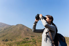 Young Woman looking though the binocular Royalty Free Stock Image