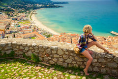 Young woman looking to the Cefalu, Sicily Royalty Free Stock Images
