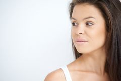 Young Woman Looking to her Right on White Royalty Free Stock Photo