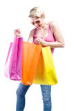 Young woman looking to her shopping bags Stock Images