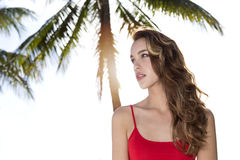 Young woman looking to the side, palm tree Stock Photo