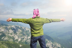Young woman looking to the sky with raised hands Stock Images