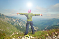 Young woman looking to the sky with raised hands Stock Photo
