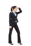 Young woman looking towards future. Full length picture of a young business woman looking far away, over a white background Stock Photography