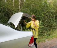 Young Woman  Looking in Trunk Royalty Free Stock Image