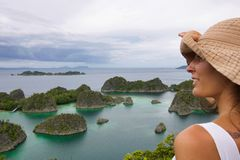 Young woman looking typical landscape of papua island stock photo