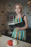 Young woman looking up in a recipes book Royalty Free Stock Photo