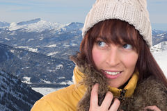 Young woman looking up in the snow covered mountains Royalty Free Stock Image