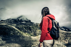 Young Woman Looking Up To The Mountain`s Peak Stock Images