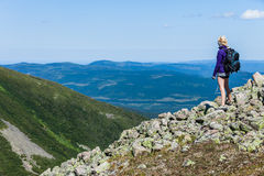 Young Woman Looking at the View From the Top of the Hill Stock Photography