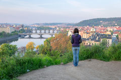Young woman looking at the Vltava river and bridges of Prague Royalty Free Stock Image