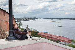 Young woman looking at wide open space of Volga river. Nizhny Novgorod, Russia Stock Images