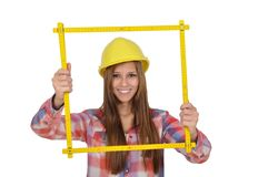 Young woman looking through a yellow ruler stock images