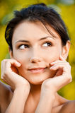 Young woman looks askance Royalty Free Stock Photography