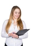 Young woman looks at a clipboard Stock Photography