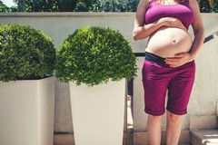 Pregnant woman outdoor. stock photos