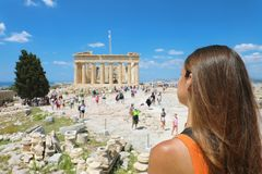 Young woman looks at Parthenon on the Acropolis of Athens, Greece. The famous ancient Greek Parthenon is the main tourist. Attraction of Athens. Girl traveler royalty free stock photography