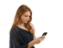 Young woman looks in phone isolated on white background Stock Photos