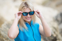 Young woman looks through tinted sunglasses at camera Stock Photography