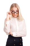 Young woman loooking over glasses Royalty Free Stock Images