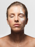 Young woman loose powder on her face Stock Photography