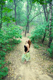 Young woman lost in a forest Royalty Free Stock Image