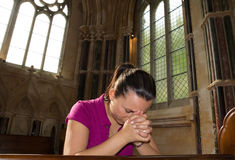 Young woman lost in pray Royalty Free Stock Image