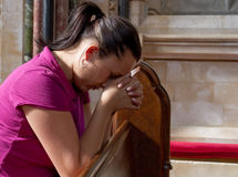 Young woman lost in pray Stock Photography