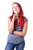 Young woman lost in thought Stock Images