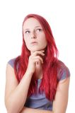 Young woman lost in thought. Young woman looking up thinking Royalty Free Stock Photography